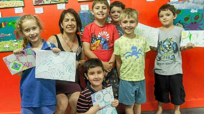 ARTS: Jenny Fournier pictured with children from her after-school art classes.