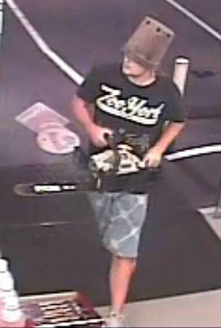 A man wielding a chainsaw and wearing a flower pot on his head was arrested by Ipswich police after an alleged armed robbery at Flinders Views on Monday.