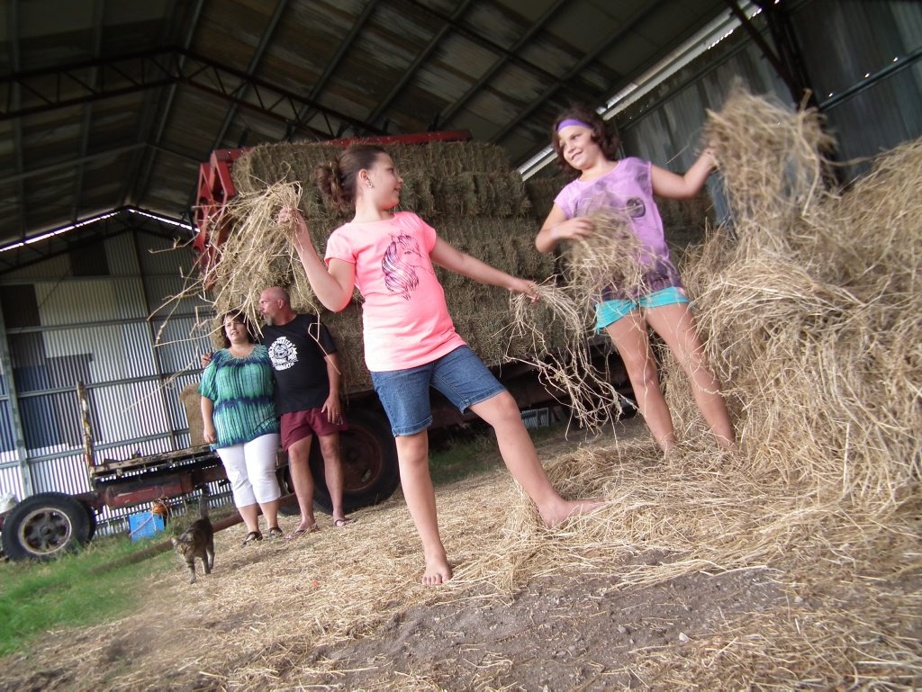 HAY THERE: The Kemps with the bales of hay they want to send out west. Photo: Contributed.