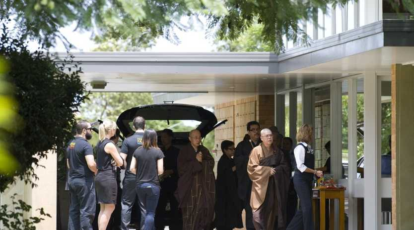 Mourners gather at the funeral of car crash victims Calvin Zhou and Grace Cai.