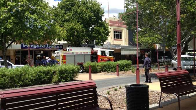 Queensland Fire and Rescue Service firefighters in East St after a pedestrian was hit by a car