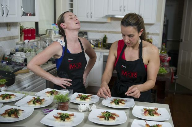 Bree and Jessica stress over their perfect scallop entree.
