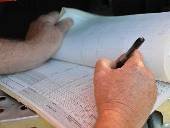 Truck driver fills out a log book Photo Carly Morrissey / Big Rigs