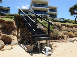 King tides create steep drops and leave stairways dangling