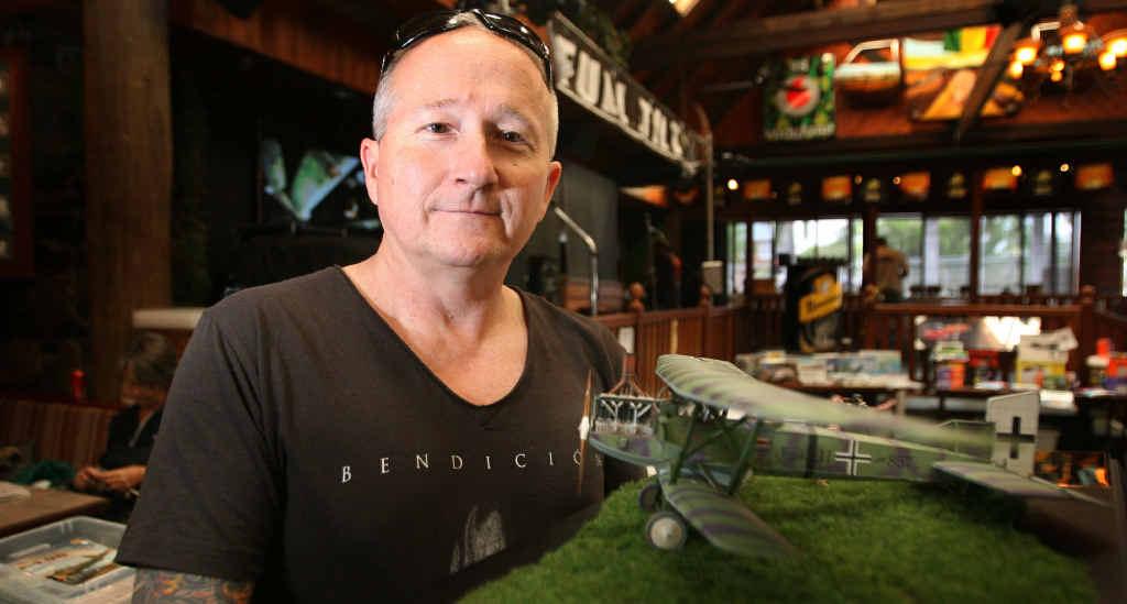 WINNERS ARE GRINNERS: Brent Simpson's German World War I plane won best model at the Queensland NNL Rockhampton Model Show.