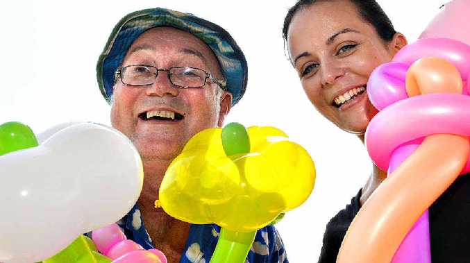 Kevin McLean, the Magical Balloon Man, brings balloons and joy to Colleen Doherty.