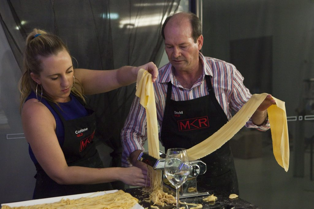 David and Corinne try to fix their angel hair pasta.