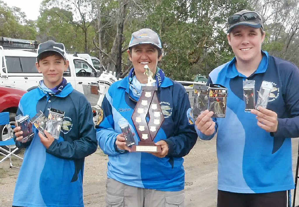 TOP ANGLERS: Jacob Box, Helen Johnson and Beau Britton with the Memorial Trophy and prizes.