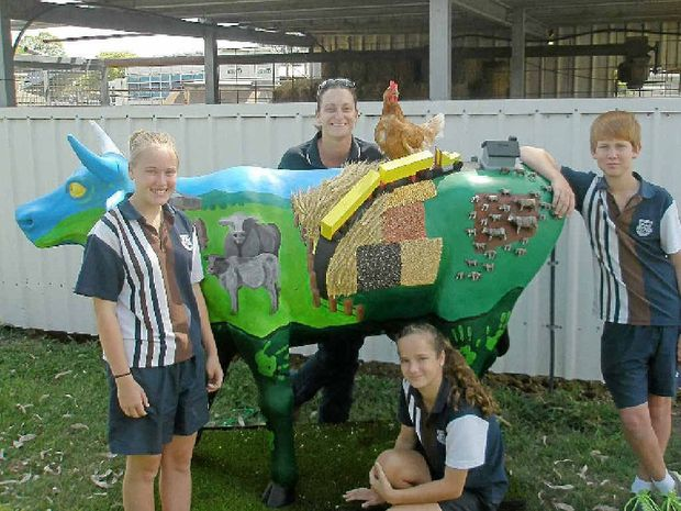 NO BULL: Rockhampton State High School Students Sascha Dobbs, Bridget Doherty and Cody Olive with agriculture teacher Janine Milne and their 2013 Archibull entry.