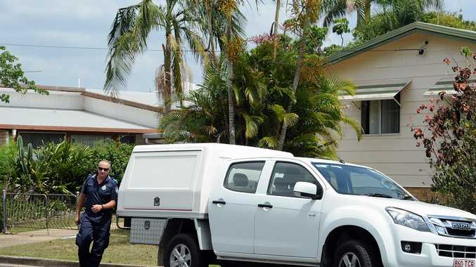 Police investigator at a crime scene in Queen St, Maryborough.