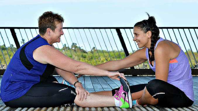 Robyn Lamont (left) and Cindy Ah-Quee warm up for a training run in preparation for the women's-only triathlon at Mirani on Sunday.