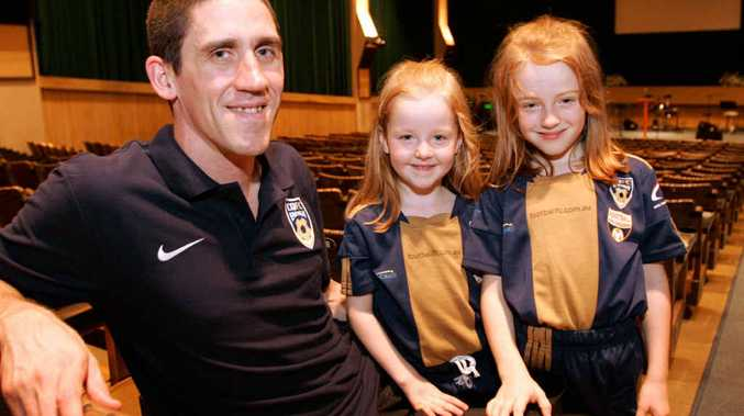 CQFC goalkeeper and St Andrew's Presbyterian Church assistant pastor Andrew Poyser with his daughters Abby, 5, and Charlotte, 7, at the church. He's in goal for CQFC on Saturday night in their friendly against Southside United.