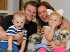 ANOTHER ONE COMING: Sami Muirhead with her family, Sam Bohner, Nixon and Avalon, and their dogs Louis and Ari.