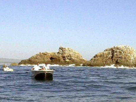 OLD DAYS: Fishermen at Julian Rocks prior to the establishment of the marine park.