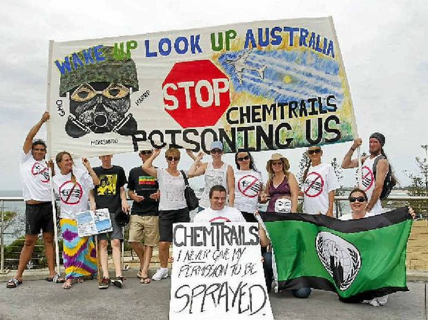 POISONED FROM ABOVE: Protesters marched from the hill at Alexandra Headland to Mooloolaba and back to raise awareness of chemtrails.