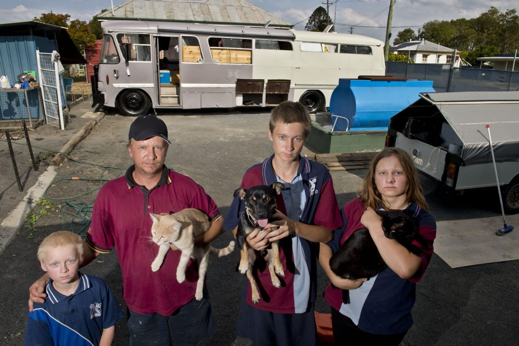 Clifton fire victims William Roberts, with Twitchy, and his children Luke, Zachary with Squirt and Tiana with Midnight.