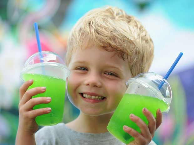 Alex Bayntun, 5, shows one way to keep cool in this hot humid weather but it requires two slushies from your parents Tropical Island slushie machine.