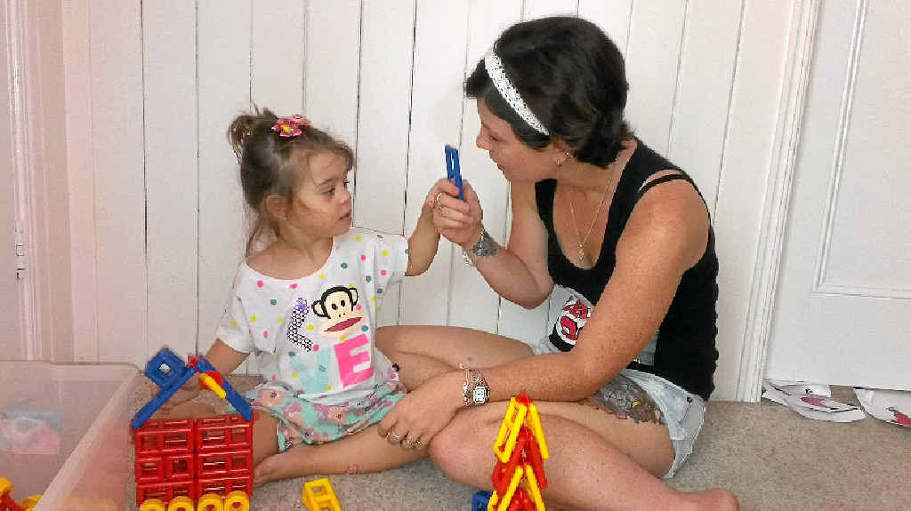 Shellie Hill uses play time to extend daughter Shalia-Kim's language skills.