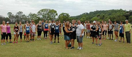 GOOD CAUSE: Jake Collins's parents, Kyleen and John Collins with bootcamp organiser Kim Andrews and surrounded by supporters.
