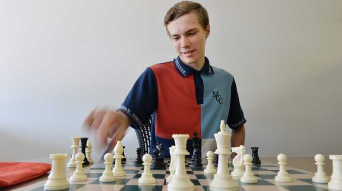 Daniel Noack makes a move in a practice game ahead of the inaugural Stan Long Hong Memorial chess tournament at Harrup Park Country Club