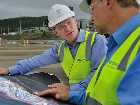 Premier Campbell Newman visits the Santos GLNG site, looking at site maps with Santos CEO David Knox.