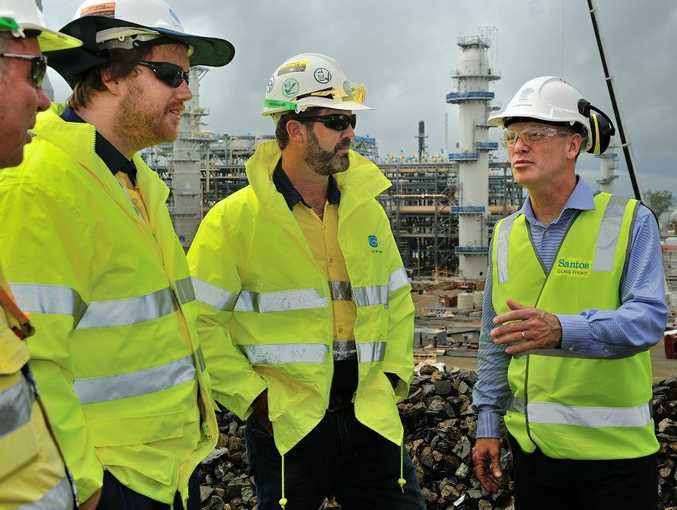 Premier Campbell Newman visited the Santos GLNG site, here talking with workers Shannon Nankivell (left) and Adam Barber.
