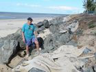 Norm Hoffman of the Toogoom Beach Progress Association with part of the unfinished seawall.