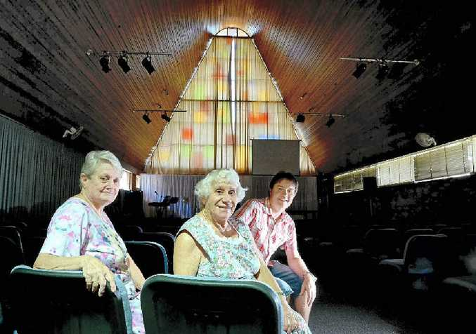 INSIDE: Pastor John Wilson and members of the congregation Marie Turnbull and Olive Laverty inside the iconic Baptist Church in Lismore.
