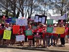 Protesters carrying placards gather outside Hervey Bay Hospital to protest changes to the Intensive Care Unit.