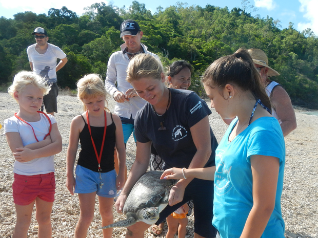 RELEASED: Sheridan Clegg, Brett Allan, Luck Saisang and Bill Edge (back) and Billie Edge, Hayley Edge, Libby Edge and Krishna Garland (front), releasing a green sea turtle back into the wild on Sunday, February 16.