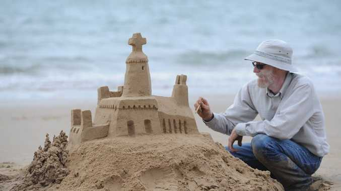 Mike Lewis from Oregon working on one of his sandcastle masterpieces on Shelly Beach.