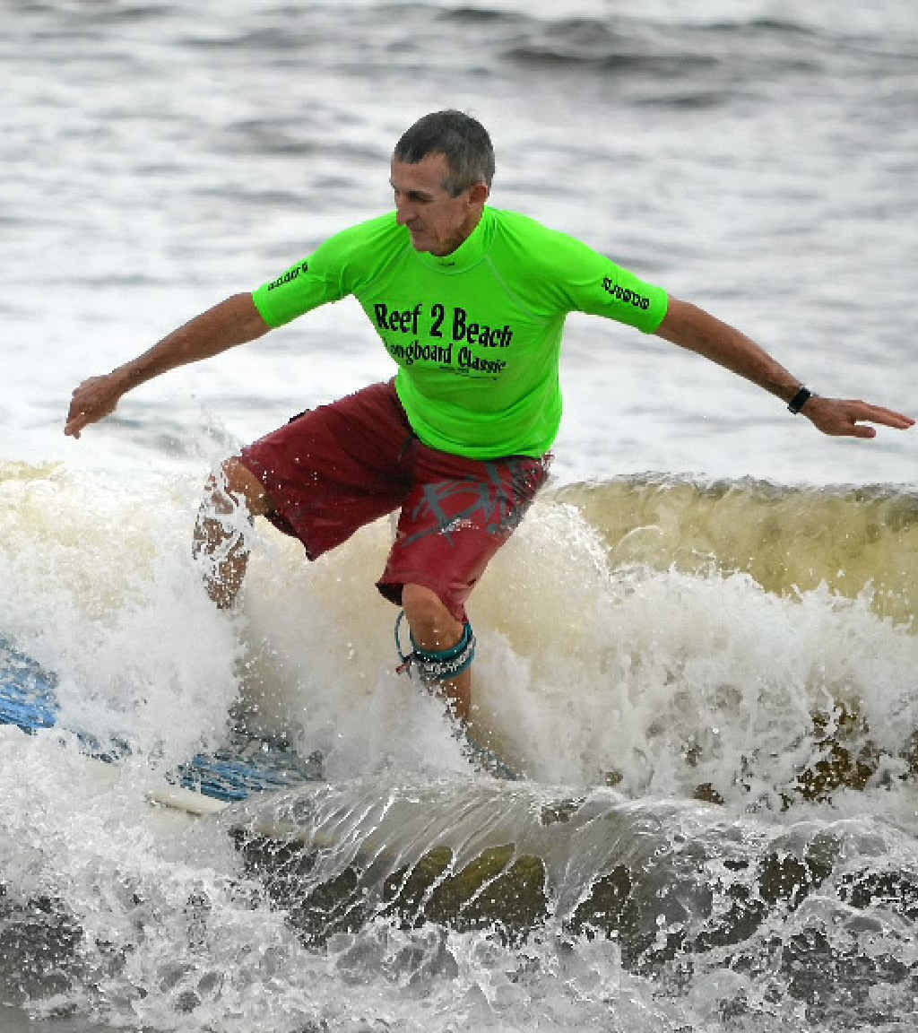 Tannum Sands' Peter Farlow finishes a good wave with a close-out re-entry in the Reef2Beach Longboard Classic.