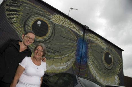 Cali Robinson (left) and Lee Howarth from the Norville Hotel check out the butterfly painted by Italian artist Hitnes.
