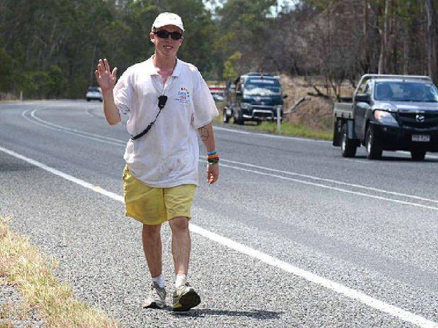 LONG WALK: Jimmy Harrington on the Bruce Hwy near Curra is on a round Australia trek to raise money for cancer.