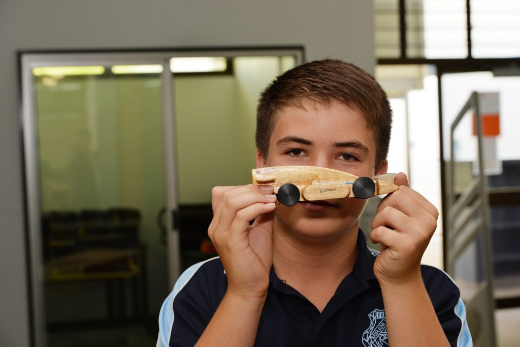 Team Manager Zac Morrison with their model racing car. Photo Peter Holt / Daily Mercury