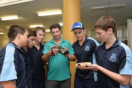 Mirani High school students prepare their model F1 racing car for the National races. from left, Zac Morrison, Ethan Grech, Isaac Connelly, Peter Leahy, who is assisting with his infrared camera, Jackson Meech and Shannon Leahy. Photo Peter Holt / Daily Mercury