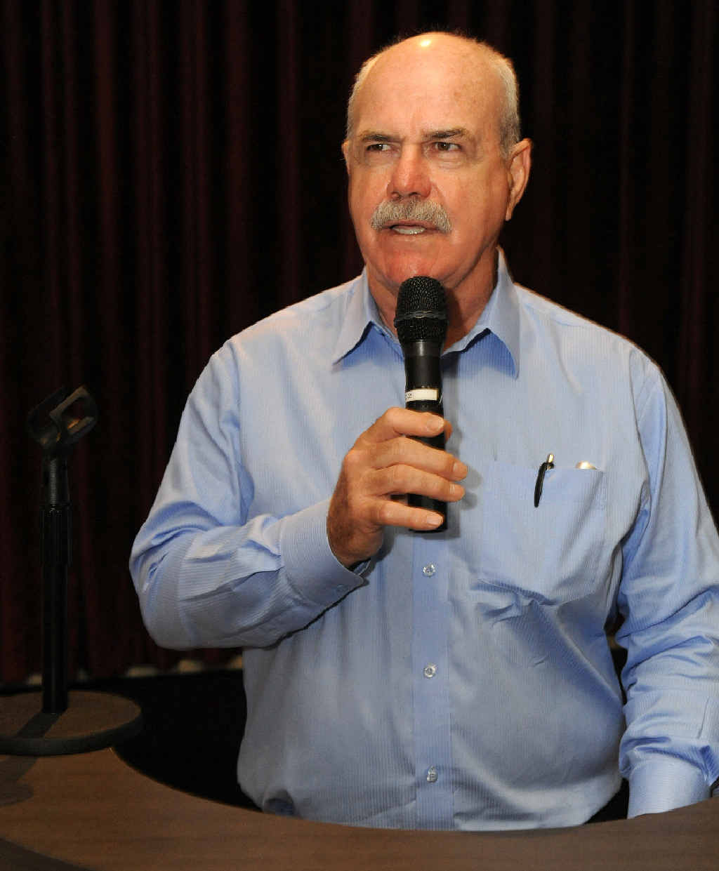 MOTIVATING: Leigh Matthews at the Link Lunch held at The Waves yesterday. INSET: Leigh Matthews playing for Hawthorn in the 1970s.