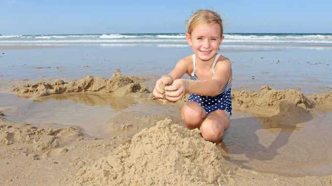IT'S BACK ... TO THE BEACH: Ella Rose, 5, of Buderim has fun in plenty of sand at Alexandra Headland this week.