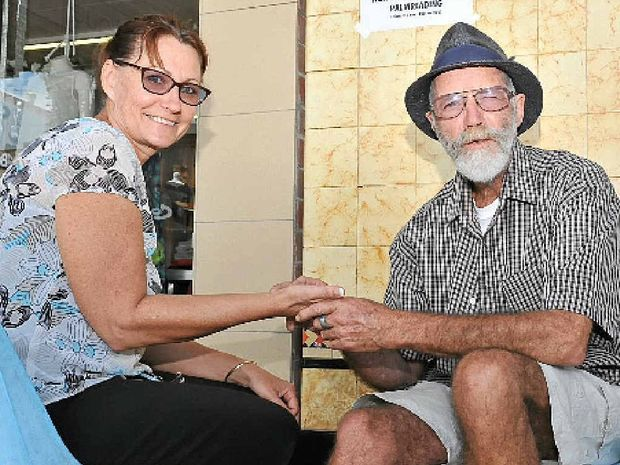 HANDY LOCATION: Shari Weston having her palm read by Peter the Reader.