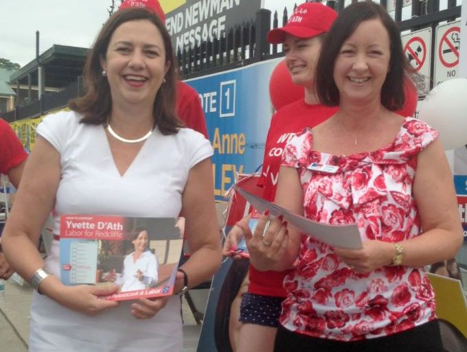 Labor candidate Yvette D'Ath (right) hands out how-to-vote cards with Queensland opposition leader Annastacia Palaszczuk at a polling booth in Redcliffe, Brisbane, Saturday, Feb 22, 2014.