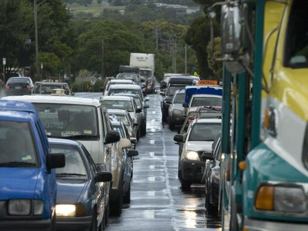 Cars back up past Cohoe St after an all-too-frequent traffic jam on the Toowoomba Range.