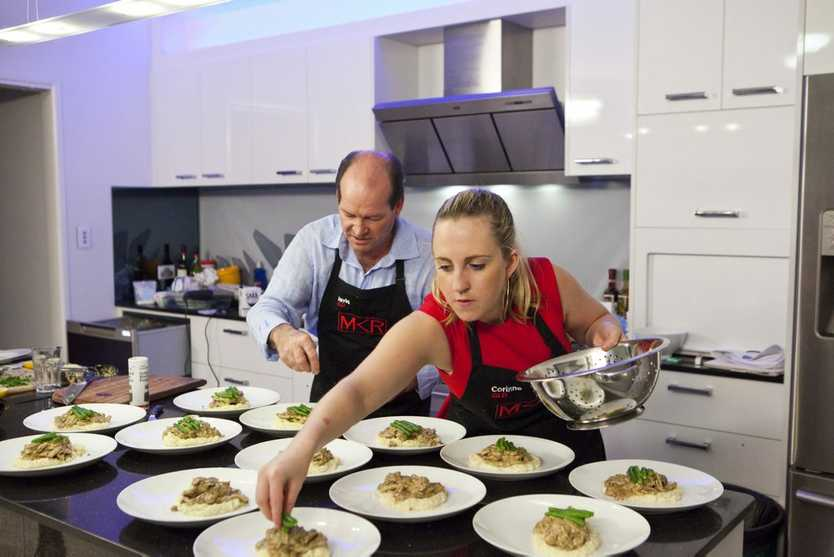 David and Corinne put the finishing touches on their main course.