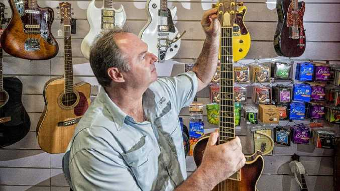 MUSIC BUSINESS: Paul Kneller of Garage Music with one of his Hard Road handmade guitars. Photo: Adam Hourigan