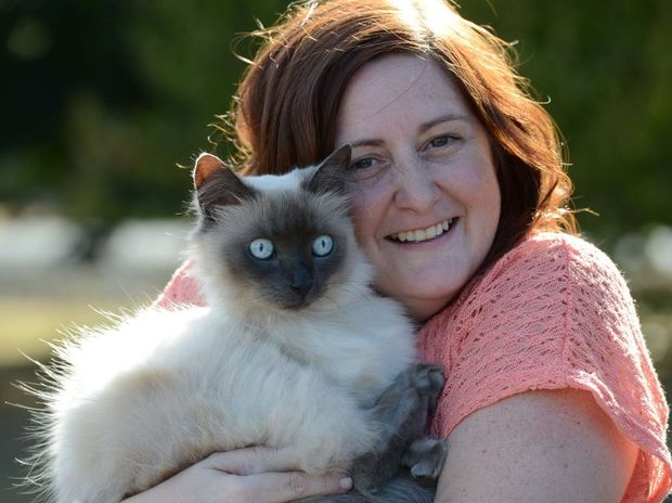 REUNITED: Rebecca Hawkins lost her cat, Hope, in Oxley three years ago. The cat turned up at an Inala vet last week.