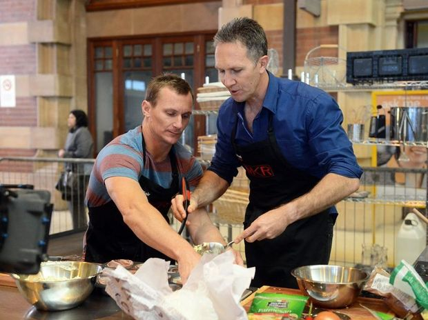 Blair and Paul cooking at Sydney's Central Station.