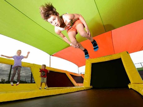 FLYING HIGH: Jayden Lippi, 11, celebrates his birthday with some jumps at the trampoline park while Edie Roslin-Clark and Stanley Roslin-Clark watch on.