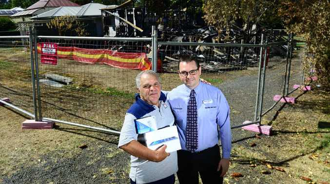 INSPIRING GIFT: Harvey Norman Computers Ipswich franchisee Chris Hard (right) presents an iPad Air to Park St fire victim Greg Hines.