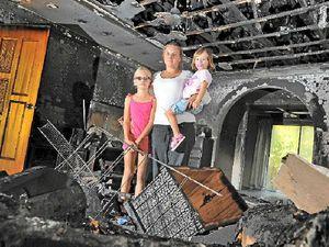 Fire destroys home but spares baby photos