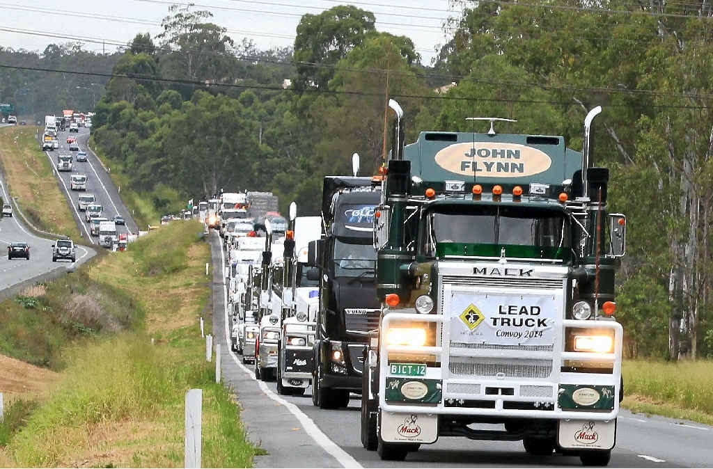 UNITED APPROACH: Trucks in the annual Light on the Hill memorial convoy head down the Warrego Hwy to Gatton on Saturday.