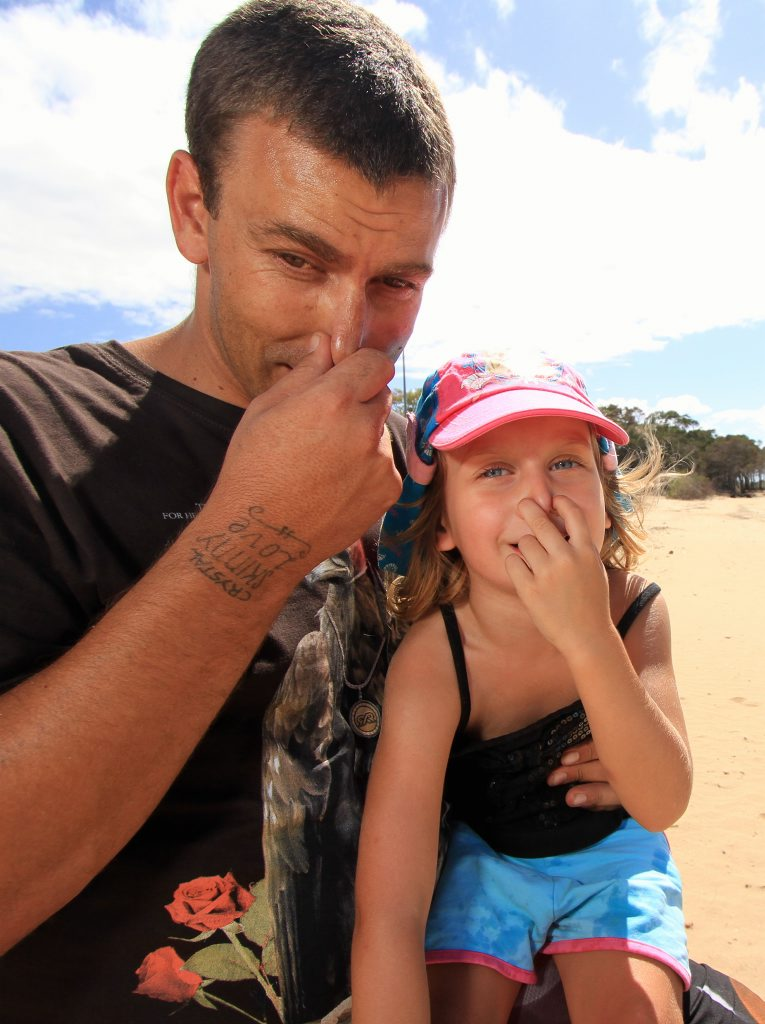 Dean and Clarissa McAskill, 4, struggled with the foul smells on part of the beach at Pialba.